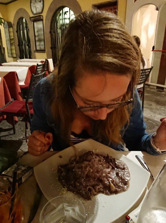 woman eating italian pasta