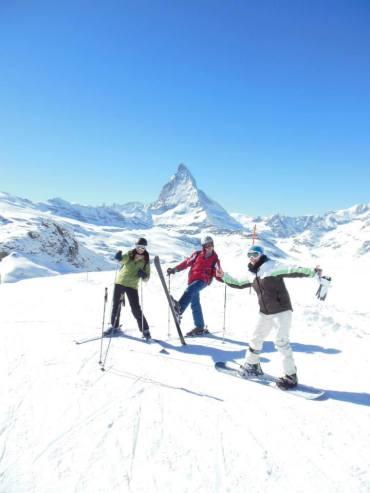 three people skiing in switzerland