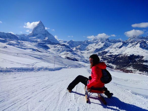 girl sledging in zermatt