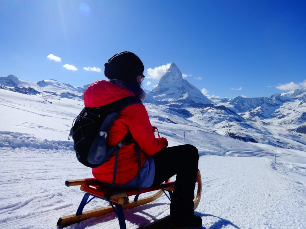 girl sledging in zermatt