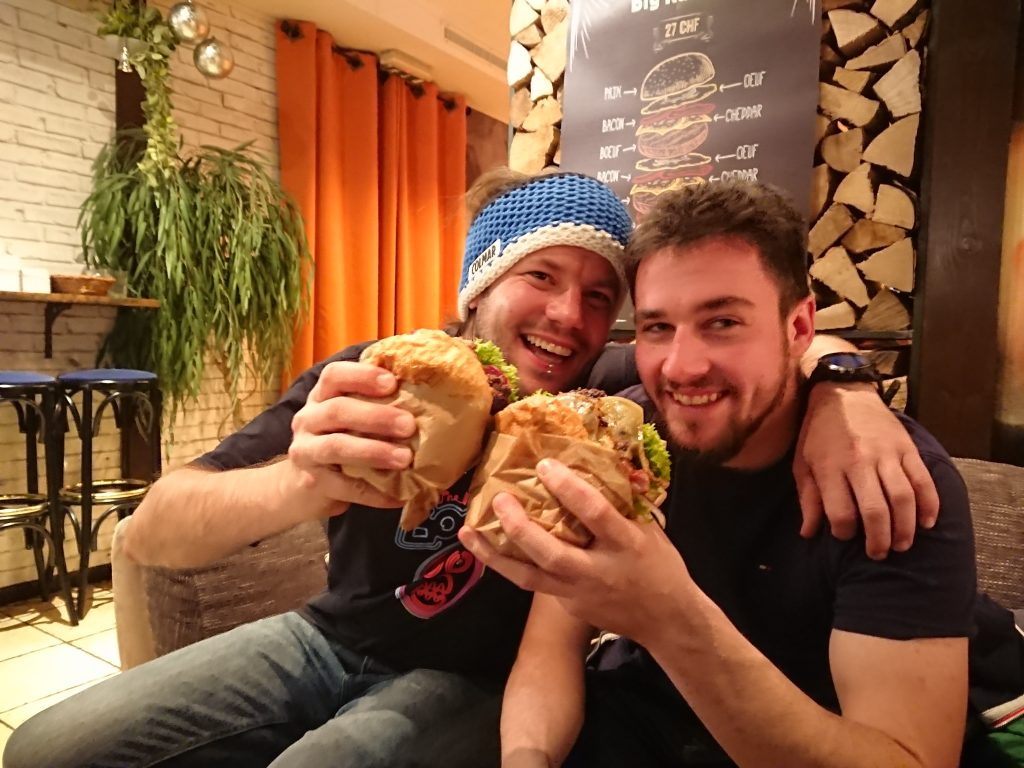 two men eating burgers