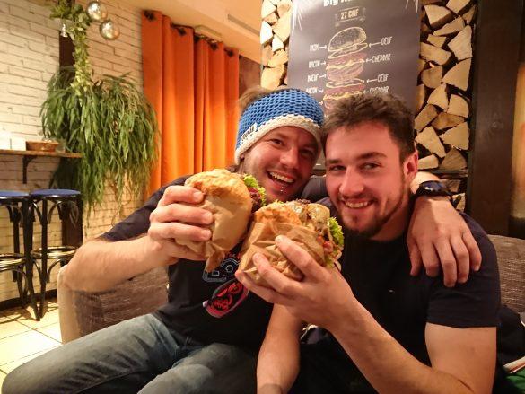 two men eating burgers