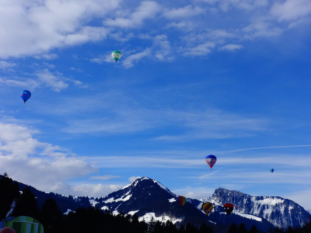 balloons flying in mountains