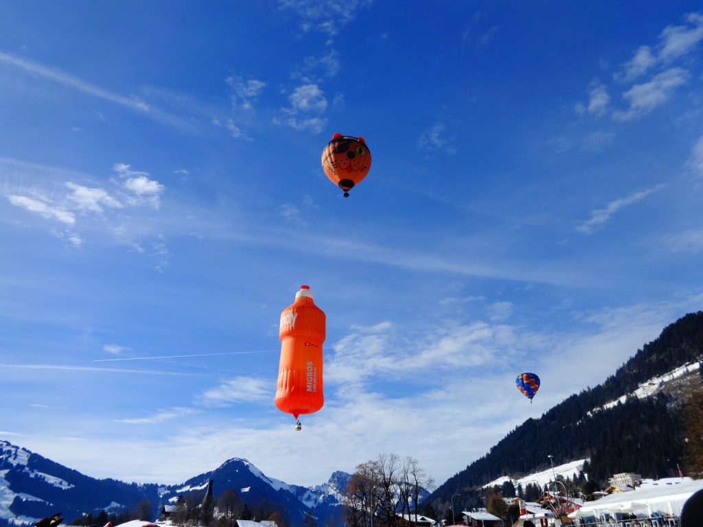 balloons flying over the mountains