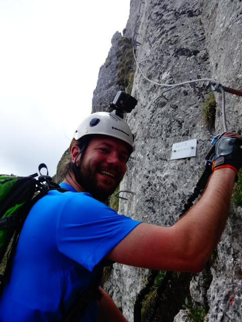 men smiling on via ferrata