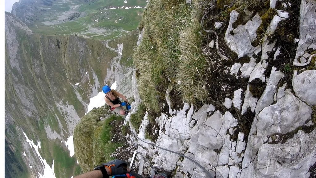 girl climbing on via ferrata Gantrisch